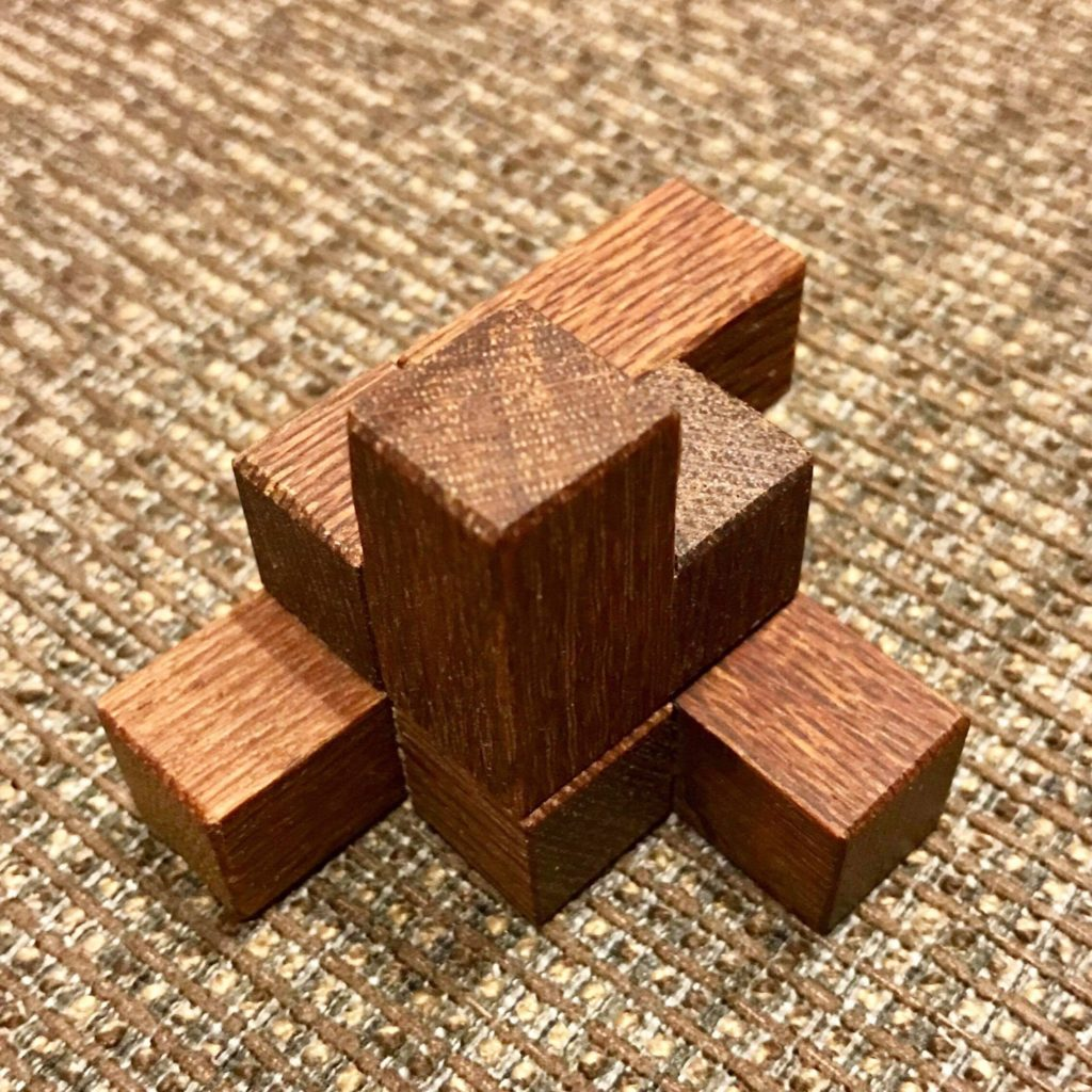 Theo Geerinck's Put Together symmetric shape Puzzle Twisted Sisters